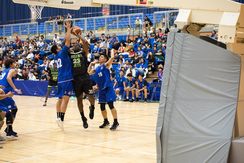 U.S. Air Force Senior Airman Sterling Tate, a Misawa Jets player and 35th Civil Engineer Squadron firefighter, rumbles forward during a layup attempt as part of the Aomori Wat's and Misawa Jets exhibition game at the Misawa International Sports Center in Misawa City, Japan, Aug. 18, 2018. Through four sweaty periods of play, Misawa's team of 11 from various backgrounds and career fields came together showcasing American esprit de corps and sportsmanship. (U.S. Air Force photo by Tech. Sgt. Benjamin W. Stratton)