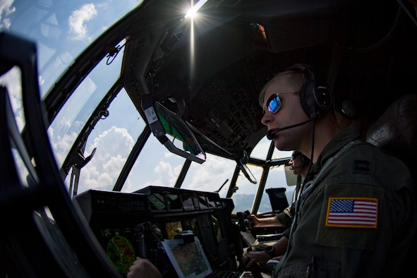 U.S. Air Force Capt. Bryant Bailey, 37th Airlift Squadron pilot, flies a C-130J Super Hercules aircraft over Romania with Lt. Col. Alex Miller, 37th AS director of operations, Aug. 21, 2018. Bailey and Miller flew low-level routes as part of exercise Carpathian Summer 2018. (U.S. Air Force photo by Senior Airman Devin Boyer)