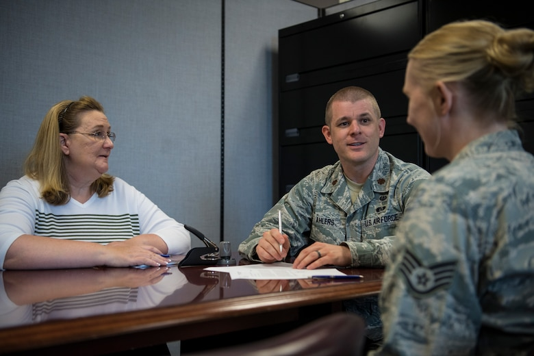 Maj. Joe Ahlers, 434th Air Refueling Wing staff judge advocate, advises an Airman on the importance of creating and maintaining a will at Grissom Air Reserve Base, Ind., Aug. 20, 2018. Ahlers was the 434th's Airman of the Year in 2008, and returned as an officer after being away for seven years. (U.S. Air Force photo / Senior Airman Harrison Withrow)
