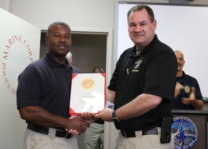 Marine Corps Logistics Base Albany Public Safety Director Paul Ellis (left) presented a 10-year length of service award to MCPD officer Derrick Jones (right), August 21. (U.S. Marine Corps photo by Re-Essa Buckels)