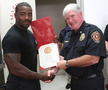 Marine Corps Logistics Base Albany Police Department Chief Randy Jack (left) presented a 10-year length of service award to MCPD officer Jeremiah Fenn (right), August 21. (U.S. Marine Corps photo by Re-Essa Buckels)