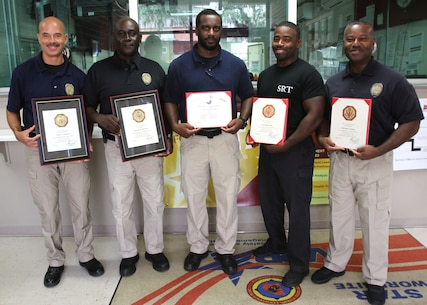 Marine Corps Logistics Base Albany Public Safety Director Paul Ellis and Police Chief Randy Jack presented several service awards to MCPD officer Sean Lamonzs, Dennis Shedrick, Willie Hall, Jeremiah Fenn and Derrick Jones, (left to right) August 21. (U.S. Marine Corps photo by Re-Essa Buckels)