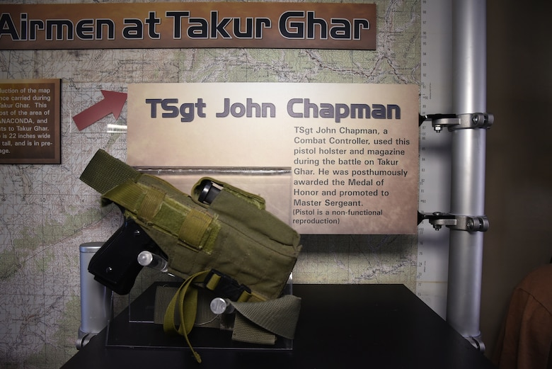 On March 4, 2002, Tech. Sgt. John Chapman sacrificed his life to preserve those of his special operations teammates during a rescue attempt on Takur Ghar mountain, Afghanistan. The Warrior Airman Exhibit at the National Museum of the U.S. Air Force displays his pistol holster and magazine used during the battle. (U.S. Air Force photo by Ken LaRock)