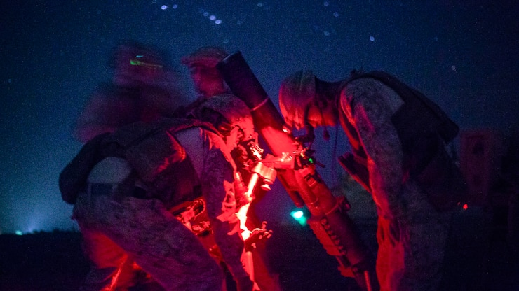 Marines set up a mortar system in Afghanistan.