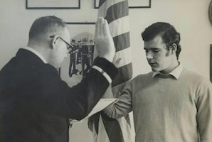 Anthony Kalkbrenner swears into the military. Kalkbrenner followed in his mother's footsteps. His mother, Helen Kalkbrenner, worked for the U.S. Foreign Service from July 1963 to October 1989.