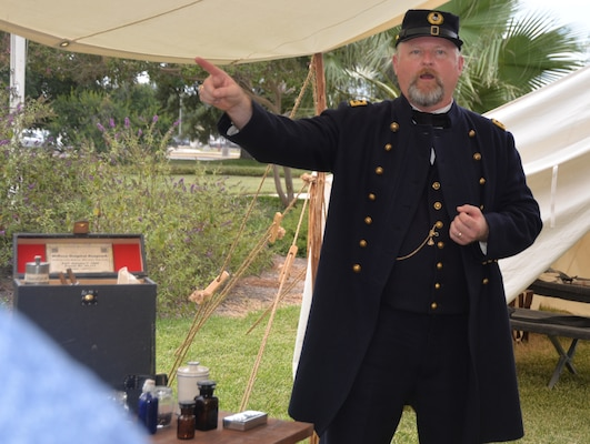 Scott Woodard, U.S. Army Medical Department Center of History and Heritage historian, wears a Civil War era military uniform as he talks about early military medicine to San Antonio community members and civic leaders gathered outside the AMEDD Museum during the Fort Sam Houston Military Medical Tour Aug. 10. The purpose of the tour, a joint effort between Brooke Army Medical Center Public Affairs and the City of San Antonio Office of Military and Veteran Affairs, was to showcase the contributions of military medicine and its impact on the San Antonio community.