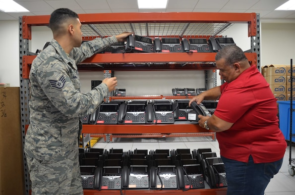 James Griffieth (right), an equipment control officer for the Air Force Technical Applications Center, Patrick AFB, Fla., examines new phones with Staff Sgt. Dali Ramos, a member of Griffieth's installation upgrade team.  The nuclear treaty monitoring center replaced more than 975 telephones to meet or exceed established security requirements.  (U.S. Air Force photo by Susan A. Romano)