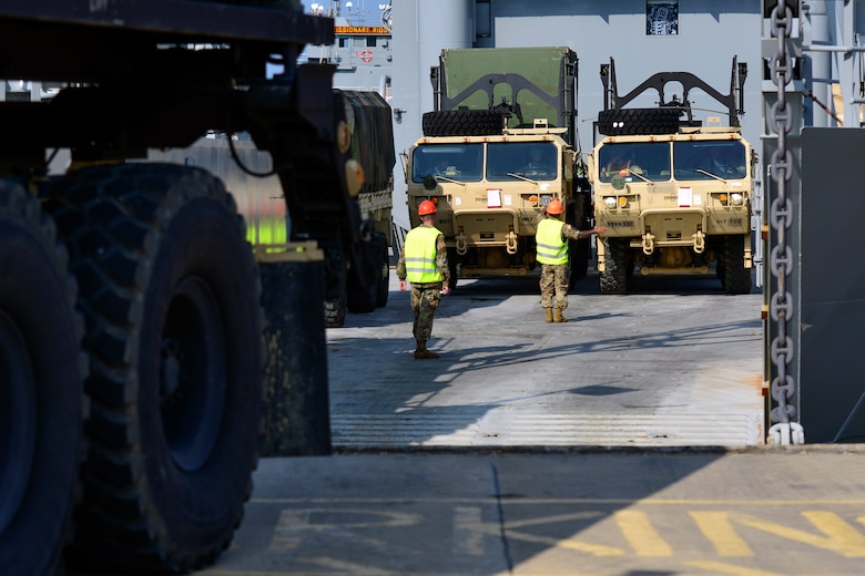 U.S. Army Soldiers assigned to the 97th Transportation Company, 10th Trans. Battalion, 7th Trans. Brigade (Expeditionary) direct vehicles onto a Landing Craft Utility vessel during a Joint Task Force Port Opening familiarization training at Joint Base Langley-Eustis, Va., Aug. 17, 2018.