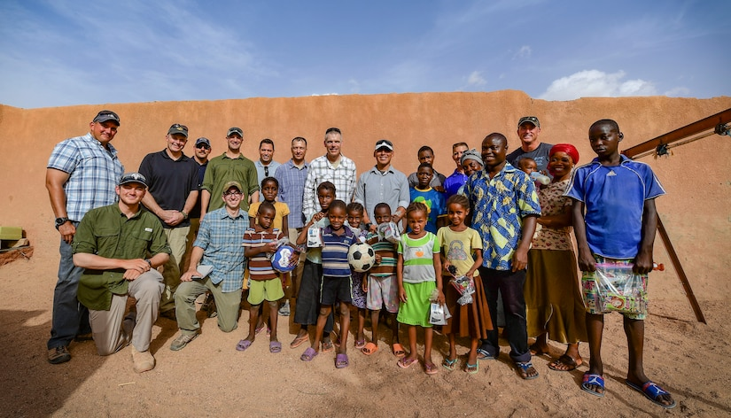 U.S. service members gather for a photo with children and volunteers from an orphanage in Agadez, Niger.