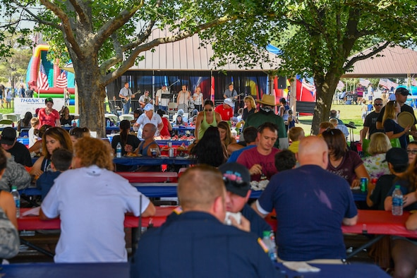 Families listen to live entertainment during the Salute Picnic Aug. 17, 2018, at Hill Air Force Base, Utah. This was the 18th year the Top of Utah Military Affairs Committee has sponsored the picnic. (U.S. Air Force photo by R. Nial Bradshaw)