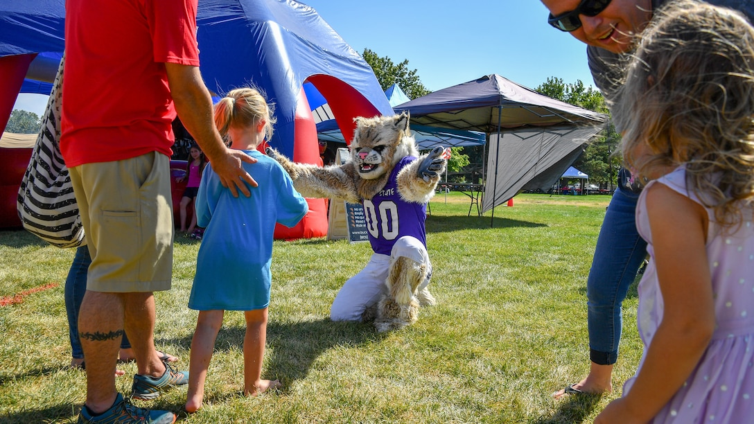 Waldo Wildcat, Weber State University's mascot, interacts with families during the Salute Picnic Aug. 17, 2018, at Hill Air Force Base, Utah. The picnic was hosted by the Top of Utah Mlitary Affairs Committee and serves to thank service members and their families for their service. (U.S. Air Force photo by R. Nial Bradshaw)