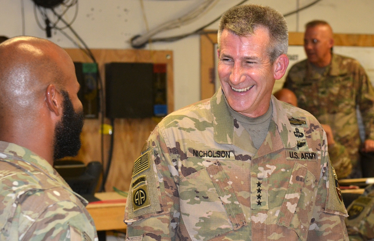 Army Gen. John W. Nicholson, commander of NATO's Resolute Support mission and U.S. forces in Afghanistan, visits with service members at Train, Advise and Assist Command East in Afghanistan's Lagham province.