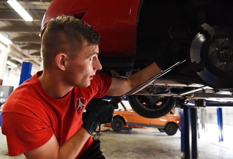 Senior Airman Chance Young, a 28th Maintenance Group squadron load crew member, replaces brakes in the auto hobby shop at Ellsworth Air Force Base, S.D., Aug. 15, 2018. The mechanics at the hobby shop are here to help Airmen and their families with their automotive repair needs and to help car enthusiasts with their projects. (U.S. Air Force Photo by Airman 1st Class Thomas Karol)
