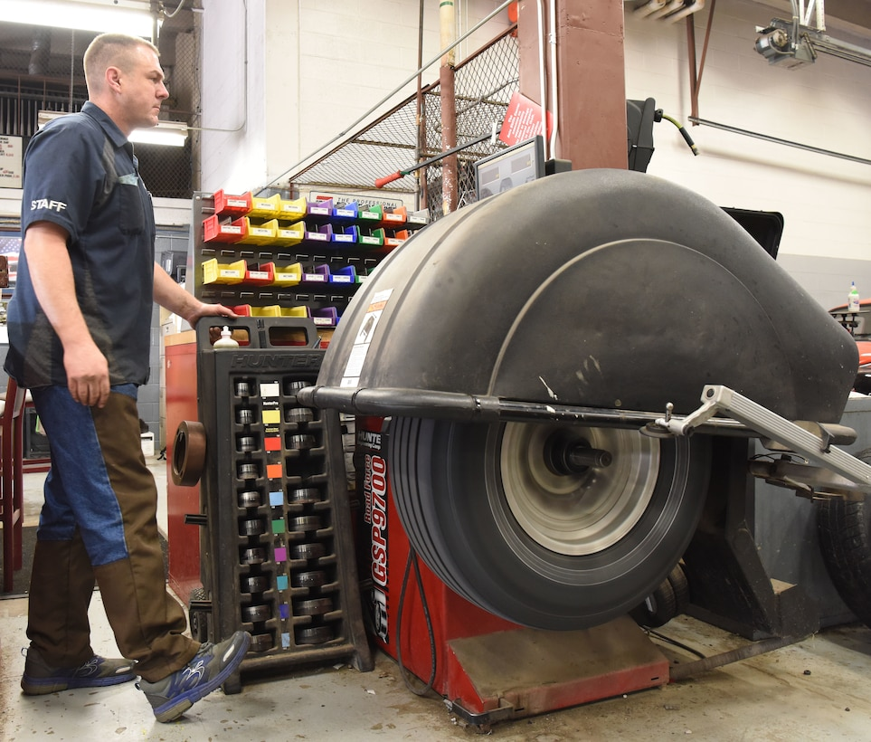 Chadwick Eldridge, a mechanics assistant at the auto hobby shop, performs a tire rotation at Ellsworth Air Force Base, S.D., Aug. 15, 2018. The mechanics at the hobby shop are here to help Airmen and their families with their automotive repair needs and to help car enthusiasts with their projects. (U.S. Air Force Photo by Airman 1st Class Thomas Karol)