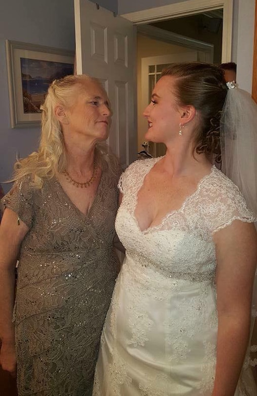 Mary Nevins and her daughter, Denise, share a smile on Denise's wedding day in Foley, Minn., Sept. 17, 2016. Mary's daughter, now Senior Airman Denise Jenson, currently works at the 28th Bomb Wing Public Affairs office at Ellsworth Air Force Base, S.D. (Courtesy photo)