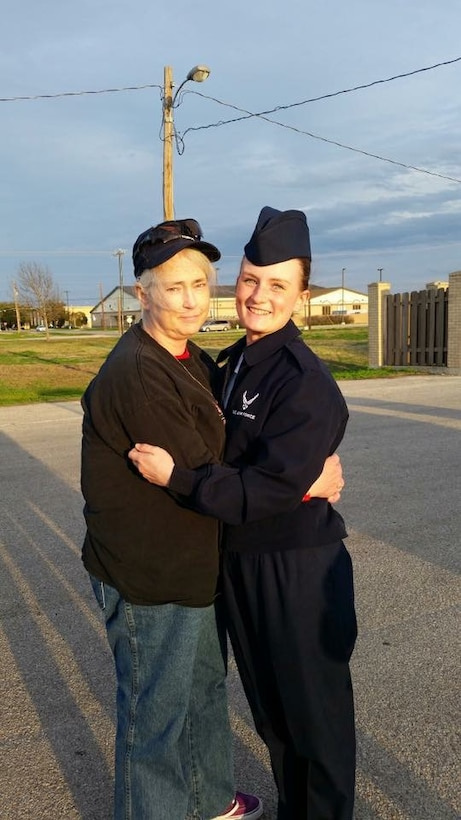 Mary Nevins (left) hugs her daughter, Denise, after her graduation from Air Force basic training at Lackland Air Force Base, Texas, Jan. 30, 2015. Mary's daughter, now Senior Airman Denise Jenson, currently works for the 28th Bomb Wing Public Affairs office at Ellsworth Air Force Base, S.D. (Courtesy photo)