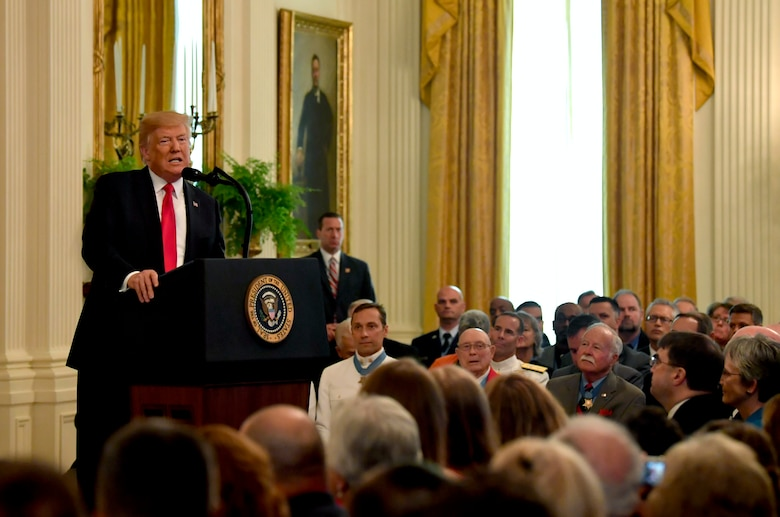 President Donald J. Trump gives his remarks during the Medal of Honor ceremony for Tech. Sgt. John Chapman at the White House in Washington, D.C., Aug. 22, 2018. Chapman was posthumously awarded the Medal of Honor for actions on Takur Ghar mountain in Afghanistan on March 4, 2002, when his elite special operations team was ambushed by the enemy and came under heavy fire from multiple directions. Chapman immediately charged an enemy bunker through thigh-deep snow and killed all enemy occupants. Courageously moving from cover to assault a second machine gun bunker, he was injured by enemy fire. Despite severe wounds, he fought relentlessly, sustaining a violent engagement with multiple enemy personnel before making the ultimate sacrifice. With his last actions, he saved the lives of his teammates. (U.S. Air Force photo by Wayne A. Clark)