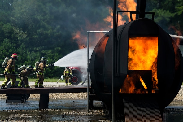 A team of Reserve Citizen firefighters respond to a simulated aircraft fire during Patriot Warrior at Dobbins Air Reserve Base, Georgia, Aug. 15, 2018. Reserve Citizen Airmen with the 446th Civil Engineer Squadron from Joint Base Lewis-McChord, Washington, 514th CES, Joint Base McGuire-Dix-Lakehurst, New Jersey and 624th CES, Joint Base Pearl Harbor-Hickam, Hawaii, trained together as one team. The Patriot Warrior exercise supports the Air Force Reserve guiding and foundational principles of preserving, building and shaping a combat ready, cost effective, experienced and sustainable professional military force. (U.S. Air Force photo by Master Sgt. Theanne Herrmann)