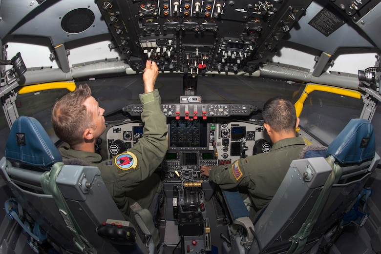 U.S. Air Force Capt. Josh Welch, left, and 2nd Lt. Kent Melendez, right, both pilots assigned to the 50th Air Refueling Squadron, perform pre-flight procedures in the KC-135 flight simulator at MacDill Air Force Base, Fla, Aug. 17, 2018.