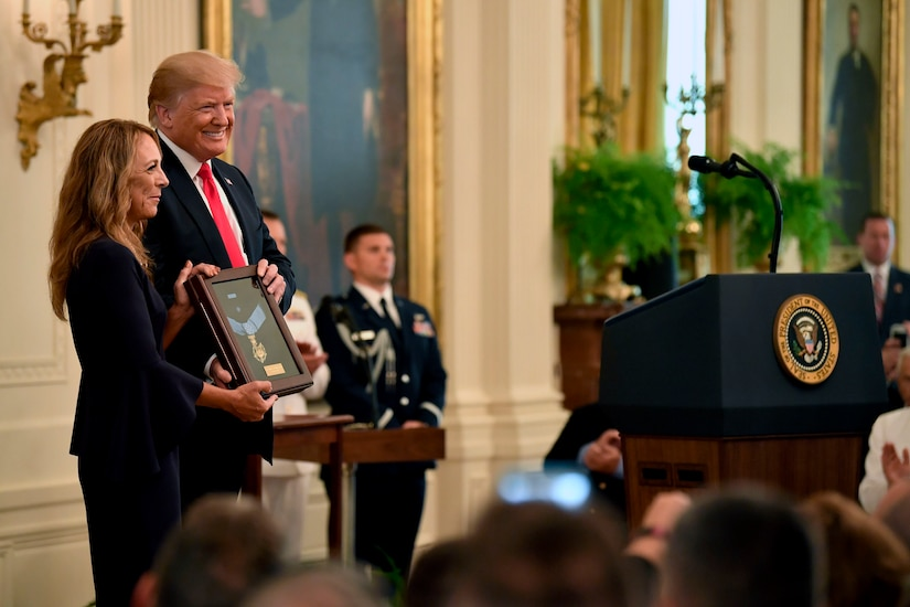 President Donald J. Trump presents the Medal of Honor to the widow of Air Force Tech. Sgt. John Chapman.