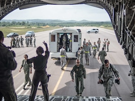 Airmen load AES and CCAT patients on to the C-17 at Fort McCoy Wis. (Air Force Photo/Paul Zadach)