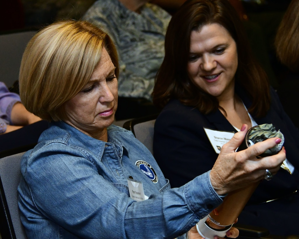 Pam Younker, left, and Sharon Mason, both civic leaders from Georgia, look at a dropsonde during a mission brief on the Air Force Reserve Hurricane Hunters as part of the 22nd Air Force Senior Leader Summit held in August 2018. Dropsondes are dropped from specially equipped C-130s during weather reconnaissance missions to measure storm conditions. (U.S. Air Force photo/Staff Sgt. Andrew Park)