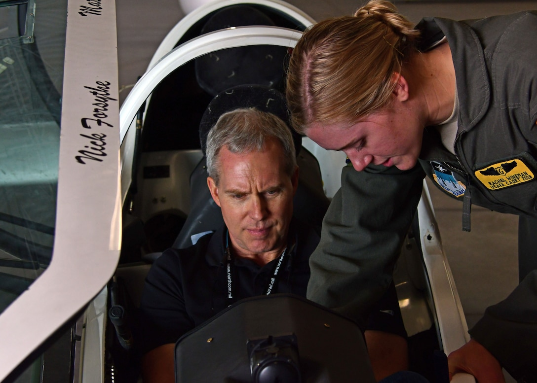 Tim Kelly, a civic leader from Georgia, sits in a glider as a U.S. Air Force Academy cadet points out controls in the cockpit during a tour August 15, 2018. Civic leaders were invited for the first time to the 22nd Air Force's Senior Leader Summit held in August 2018. (U.S. Air Force photo/Staff Sgt. Andrew Park)