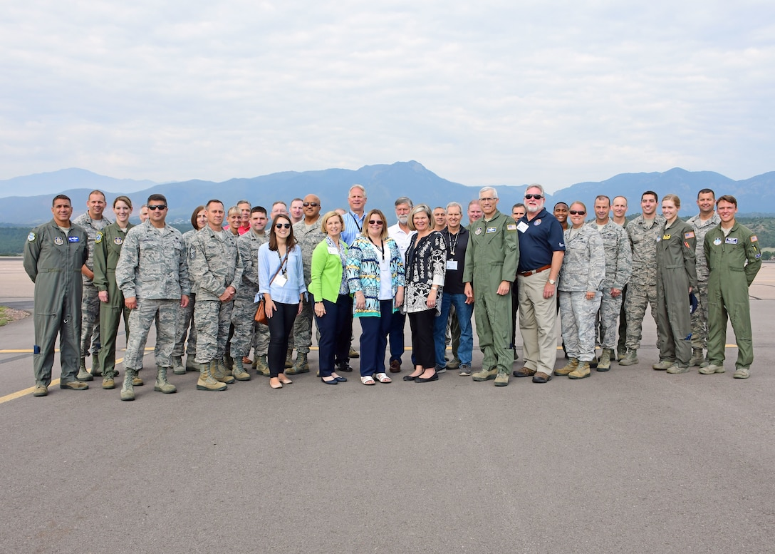 Participants in the 22nd Air Force Senior Leader Summit pose for a group photo by the U.S. Air Force Academy flightline Aug. 15, 2018. Military members and civilians embarked on a variety of tours to learn more about the Air Force as a whole, as well as the unique mission sets that make up the command. (U.S. Air Force photo/Staff Sgt. Andrew Park)