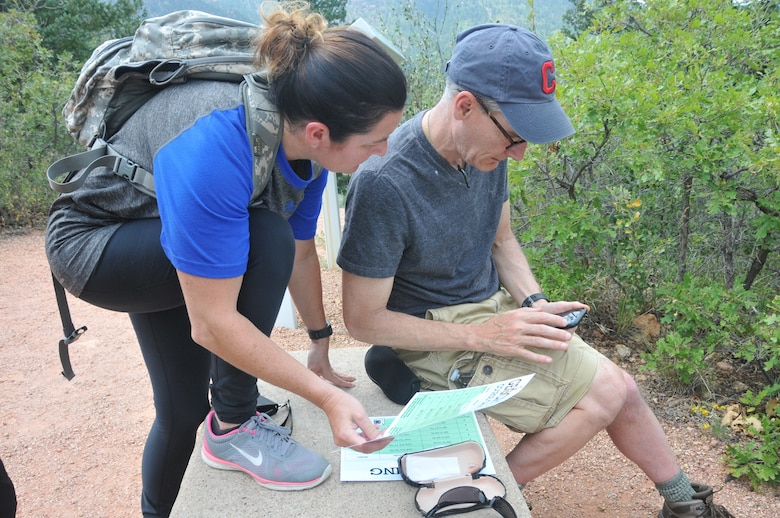 Participants in the 22nd Air Force Senior Leader Summit use GPS coordinates to find a puzzle piece during a geocaching exercise in the Rocky Mountains August 15, 2018. The exercise was held on the final day of the summit and provided participants the opportunity to enhance their teamwork and problem-solving skills. (U.S. Air Force photo/2nd Lt. Casey Mull)