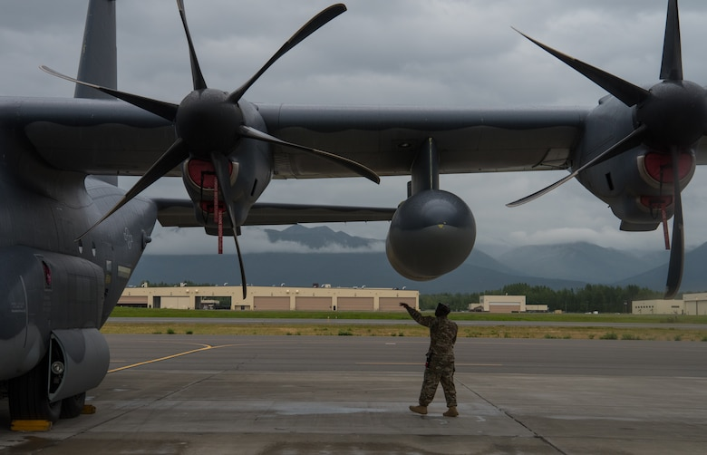 U.S. Air Force Master Sgt. Rick Moore, 353rd Special Operations Maintenance Squadron productions superintendent, performs a pre-flight inspection on a C-130J Super Hercules from Kadena Air Force Base, Japan, during Red Flag-Alaska 18-3 at Joint Base Elmendorf-Richardson, Alaska, Aug. 13, 2018. RF-A serves as an ideal platform for international engagement and the exercise has a long history of including allies and partners, ultimately enabling all involved to exchange tactics, techniques and procedures while improving interoperability.