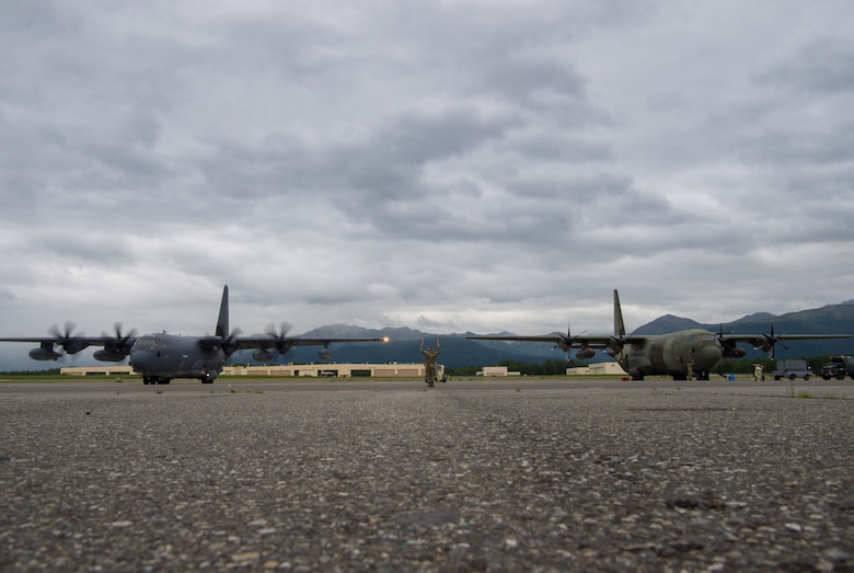 A C-130J Super Hercules from Kadena Air Force Base, Japan, and a C-130J Hercules from the United Kingdom Royal Air Force prepare for flight during Red Flag-Alaska 18-3 at Joint Base Elmendorf-Richardson, Alaska, Aug. 13, 2018. In RF-A 18-3 U.S. Army and Navy aviators in addition to Air Force Airmen are expected to fly, maintain and support more than 100 aircraft from more than a dozen units during this iteration of the exercise.