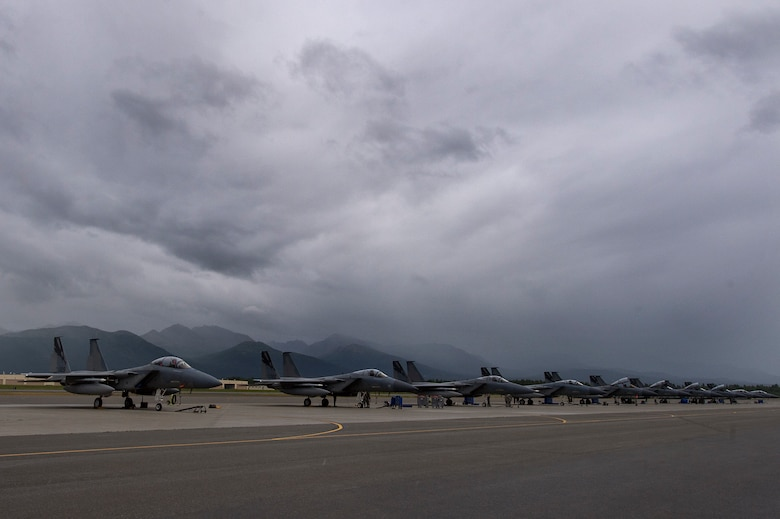 F-15C Eagle aircraft from the 144th Fighter Wing, Fresno Air National Guard Base, California, rest on the flightline during Red Flag-Alaska 18-3 at Joint Base Elmendorf-Richardson, Alaska, Aug. 13, 2018. RF-A is a Pacific Air Forces-directed field training exercise for U.S. and international forces flown under simulated air combat conditions. RF-A serves as an ideal platform for international engagement and the exercise has a long history of including allies and partners, ultimately enabling all involved to exchange tactics, techniques and procedures while improving interoperability.