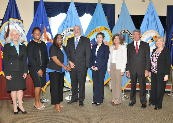 Women's Equality Day panelists pose with senior leaders from DCAA, DTIC, DLA and DTRA.