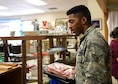U.S. Air Force Airman 1st Class Joel Bell, 355th Aircraft Maintenance Squadron crew chief, shops at the Davis-Monthan Thrift Shop at D-M Air Force Base, Ariz., August 22, 2018.