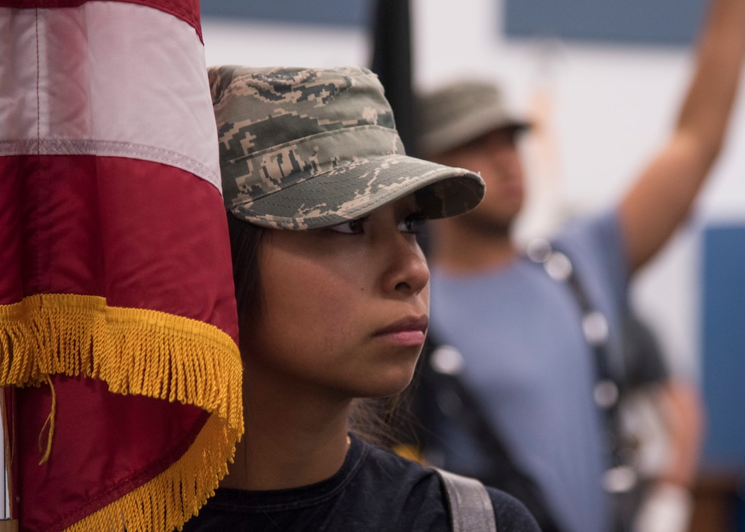 A base Honor Guard trainee pays attention to flag bearing instruction at Fairchild Air Force Base, Washington, Aug. 4, 2018. Honor Guard trainees practice through the weekend during their training phase, as they will perform ceremonies any day of the week for a four month term. (U.S. Air Force photo/Senior Airman Ryan Lackey)