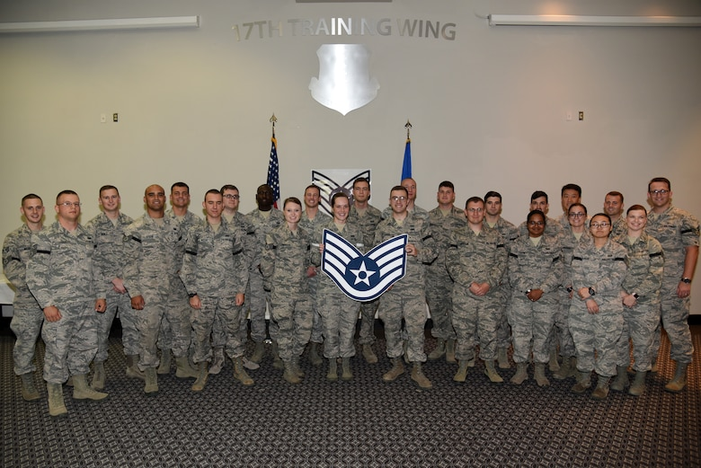 Senior airmen pose for a photo during the Staff Sergeant Release Party at the Event Center on Goodfellow Air Force Base, Texas, Aug. 22, 2018. These senior airmen will make the transition to staff sergeant though the course of the year. (U.S. Air Force photo by Staff Sgt. Joshua Edwards/Released)