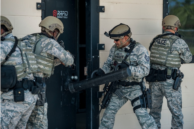 Members of the 6th Security Forces emergency services team (EST) breach an assault door during a training scenario at MacDill Air Force Base, Fla., Aug. 23, 2018.