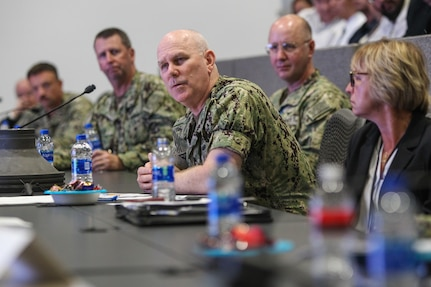 Adm. Christopher Grady, U.S. Fleet Forces Commander, asks a question during a visit at Naval Surface Warfare Center, Corona Division (NSWC Corona).