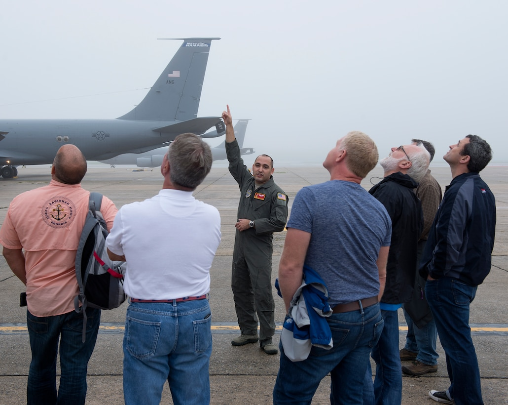 Staff Sgt. Hector M. Acevedo II, a 64th Air Refueling Squadron boom operator, gives local employers a tour of a KC-135 Stratotanker on Aug. 14, 2018 at Pease Air National Guard Base, N.H. The tour preceded a trip to Camp Grayling, Michigan where their employees, soldiers assigned to the 197th Field Artillery Brigade, N.H. Army National Guard, conducted their annual training. (Photo by Staff Sgt. Kayla White, 157th Air Refueling Wing Public Affairs)