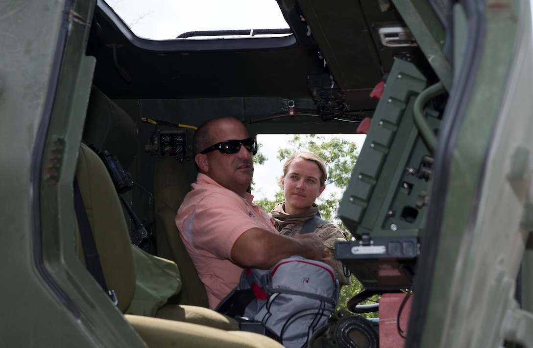 Sgt. Mackenzie C. Sickel, a HIMARS crew chief assigned to the 197th Field Artillery Brigade, N.H. Army National Guard, gives a tour of the weapon system to Jason J. LaVoie, the chief of the Hudson Police Department, on Aug. 14, 2018 at Camp Grayling, Mich. Lavoie visited as part of a N.H. Employer Support of the Guard and Reserve tour during the 197th FAB annual training event. (Photo by Staff Sgt. Kayla White, 157th Air Refueling Wing Public Affairs)
