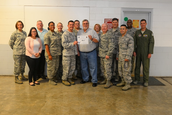 "James Brown, 47th Logistics Readiness Flight installation deployment officer, was chosen by wing leadership to be the ""XLer"" of the week, for the week of August 13, 2018, at Laughlin Air Force Base, Texas. The ""XLer"" award, presented by Col. Charlie Velino, 47th Flying Training Wing commander, is given to those who consistently make outstanding contributions to their unit and the Laughlin mission. (U.S. Air Force photo by Senior Airman Benjamin N. Valmoja)"