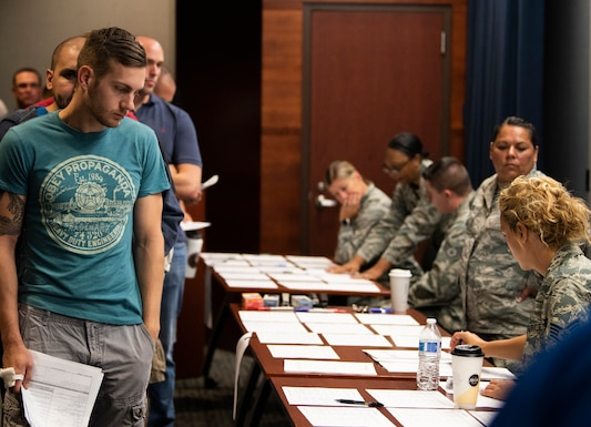 Individual Ready Reserve members wait in line for assistance from 310th Space Wing and 302d Airlift Wing personnel during an IRR muster at Peterson Air Force Base, Aug. 17, 2018.