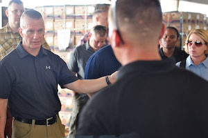 Army Command Sgt. Maj. John Wayne Troxell, senior enlisted advisor to the chairman of the Joint Chiefs of Staff, speaks with a Defense Department K-9 handler at the Pharr, Texas, port of entry.