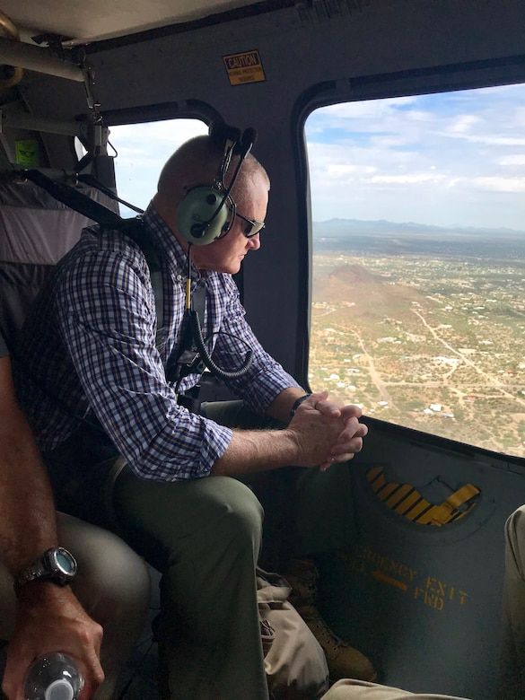Marine Corps Sgt. Maj. Paul McKenna of North American Aerospace Defense Command and U.S. Northern Command surveils the rural, expansive U.S.-Mexico border area from a Black Hawk helicopter.