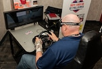 Land and Maritime associate tests out an impairment simulator