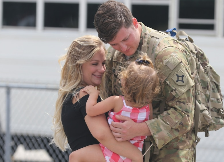 Spc. Alexander Rowland greets his wife and daughter at Jacksonville International Airport near Jacksonville, Florida, on April 29, 2017, after returning from a deployment. The DOD announced on Aug. 13, 2018 that eligibility for Military OneSource benefits for service members and their families has been extended from the current 180 days to 365 days after separation or retirement from military service.  (Photo Credit: U.S. Army photo by Staff Sgt. Shane Klestinski)