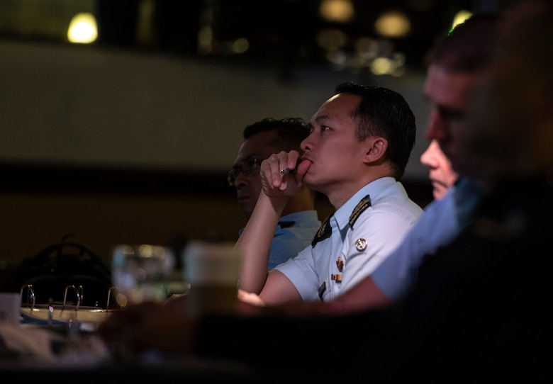 Officers of allied and partner nations listen to a briefing during the 2018 Fighter Logistics and Safety Symposium Aug. 21, 2018, at Kadena Air Base, Japan. Air force officers from Australia, Indonesia, Japan, the Philippines, Singapore and Thailand attended the symposium to boost fighter interoperability within the Pacific region. (U.S. Air Force photo by Staff Sgt. Micaiah Anthony)