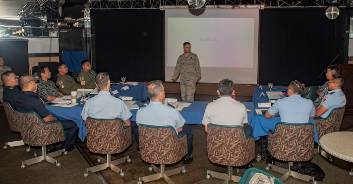 U.S. Air Force Maj. Michael Pepper, Pacific Air Forces logistics engagements officer, briefs officers of allied and partner nations during the 2018 Fighter Logistics and Safety Symposium Aug. 21, 2018, at Kadena Air Base, Japan. Air force officers from Australia, Indonesia, Japan, the Philippines, Singapore, Thailand and the U.S. conducted briefings about challenges, solutions or unique procedures related to their fighter aircraft. (U.S. Air Force photo by Staff Sgt. Micaiah Anthony)
