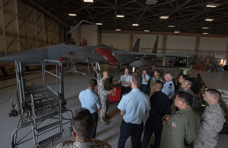 U.S. Air Force Tech. Sgt. Gene San Nicolas, 18th Equipment Maintenance Squadron aircraft inspection NCOIC, briefs officers of allied and partner nations about aircraft ground equipment during the 2018 Fighter Logistics and Safety Symposium Aug. 21, 2018, at Kadena Air Base, Japan. During the symposium, air force officers from Australia, Indonesia, Japan, the Philippines, Singapore, Thailand and the U.S. exchanged solutions to common challenges faced in the fighter community. (U.S. Air Force photo by Staff Sgt. Micaiah Anthony)