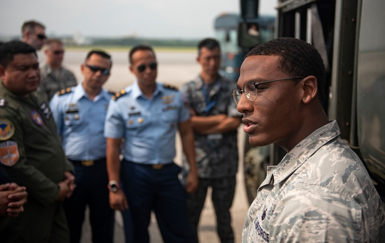 U.S. Air Force Staff Sgt. Jerald Hickmon, 18th Logistics Readiness Squadron Fuels Service Center NCOIC, briefs officers of allied and partner nations about aircraft fueling operations during the 2018 Fighter Logistics and Safety Symposium Aug. 21, 2018, at Kadena Air Base, Japan. The symposium enabled air force officers from Australia, Indonesia, Japan, the Philippines, Singapore and Thailand to visit fighter support units assigned to the 18th Wing and interact with Airmen who support the fighter mission. (U.S. Air Force photo by Staff Sgt. Micaiah Anthony)